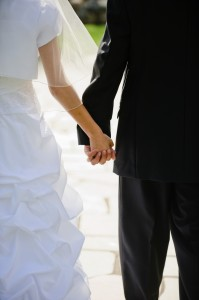 Pre-marriage bride & groom hold hands