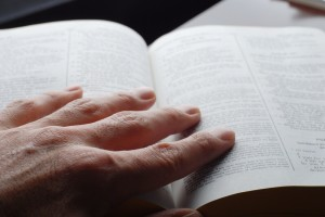 Hand on open Bible